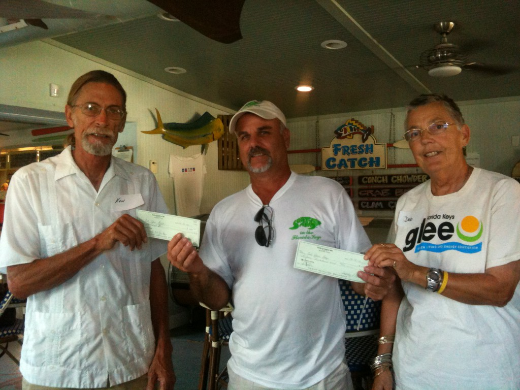 Thanks to our founding sponsor Save-A-Turtle, which donated $2,500. Harry Appel, Save-A-Turtle board member (center) with Ken Chopcinski and Deb Curlee, Got Your Bags-Florida Keys. This donation will be used to get the program started with reusable bags and fund operating and outreach expenses. Save-A-Turtle is based out of Marathon and is a strong supporter of the Got Your Bags Florida Keys program.