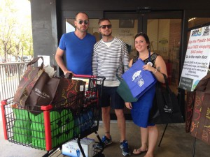 These shoppers took advantage of Winn Dixie's BOGO special on store-brand reusable bags to supplement their supply of bags. A GYB volunteer holds a Save-A-Turtle bag and a Capital Bank bag available for free to shoppers who pledged to 'skip the plastic bag'